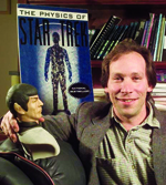 Lawrence Krauss posing with Spock doll